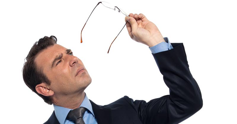 image of man checking spectacles